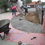 Pouring a driveway extension.